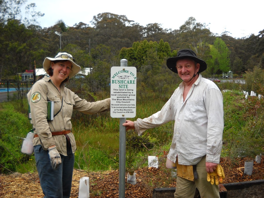 Erin Hall and Ray Richardson with new bushcare sign